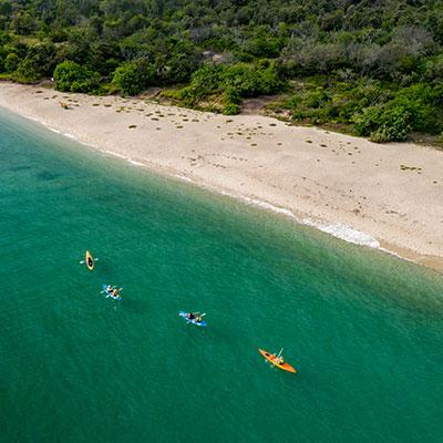 AKA-Kayakers-Along-Beach