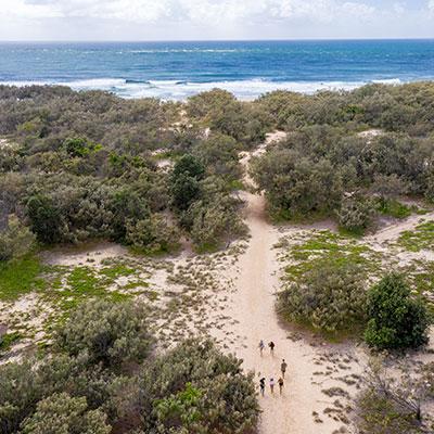 AKA-People-Walking-on-Beach